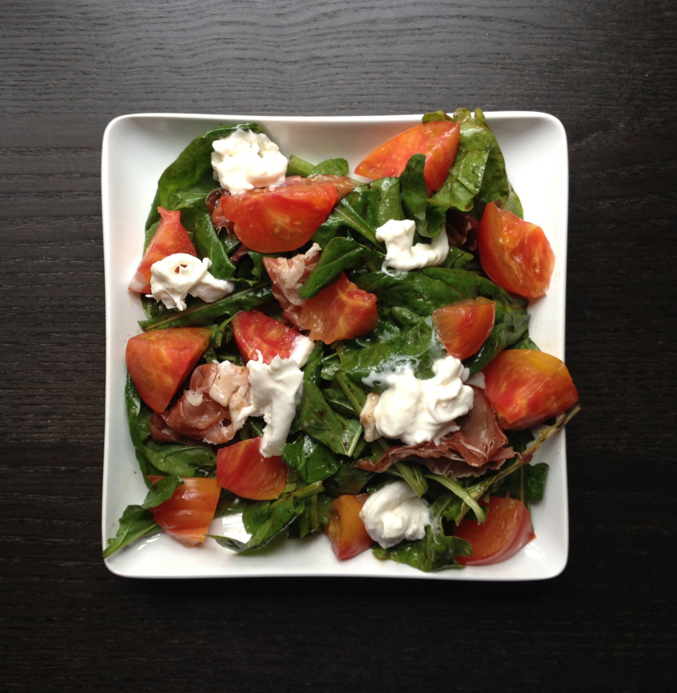 ... spinach and wild arugula tossed with a simple balsamic vinaigrette