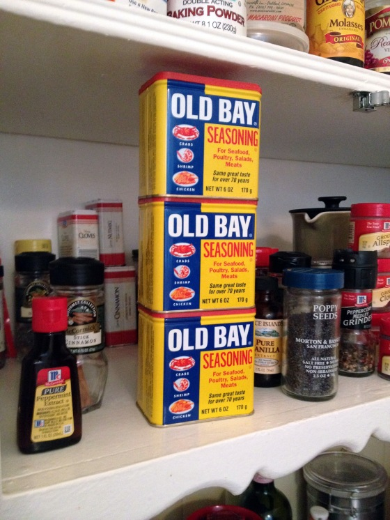 Three cans of Old Bay