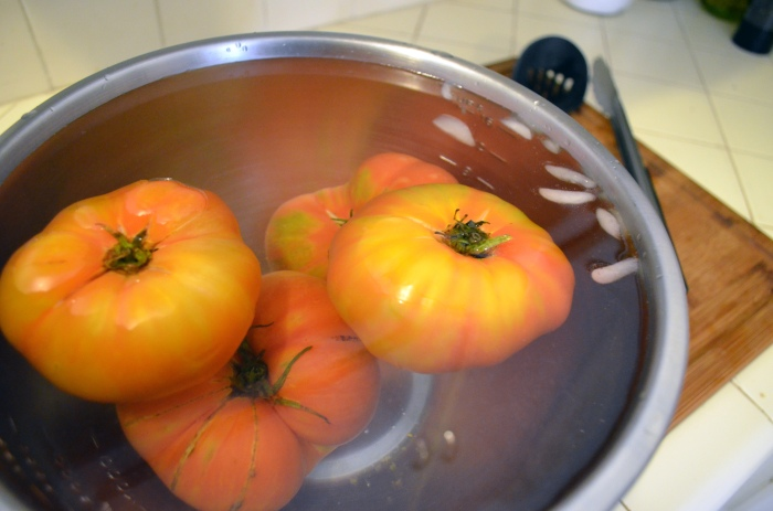 tomatoes in an icebath