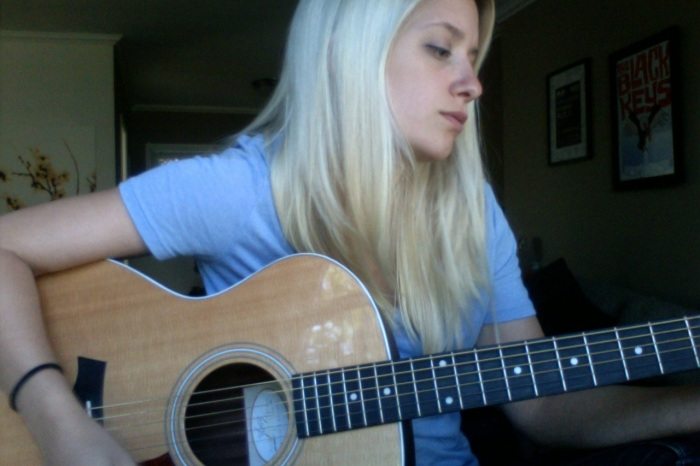 blue shirt with taylor guitar